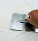 Putz mit Glättkelle auftragen. Foto: Baumit