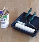 Diese Materialien werden zum Einölen des Holzbodens gebraucht. Foto: Auro