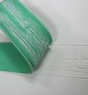 Den Silikonstempel in den weichen Putz drücken und abziehen. Foto: Baumit